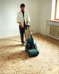 Sanding removes the face tape off the parquet tiles