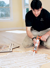 Using adhesive to install wood floor medallions