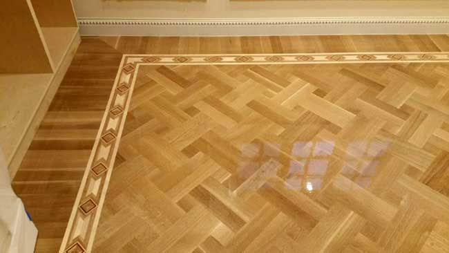 493: B11 border with double basket weave parquet in Rift white oak