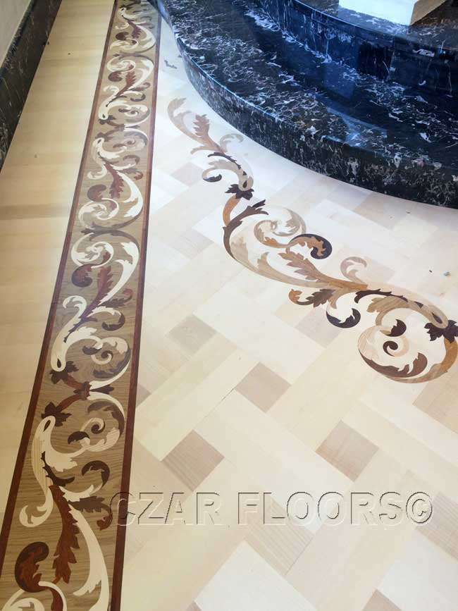 482: Wood floor border and free-form inlay in maple parquet
