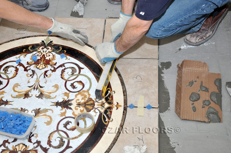 Leveling waterjet stone medallion with tiles