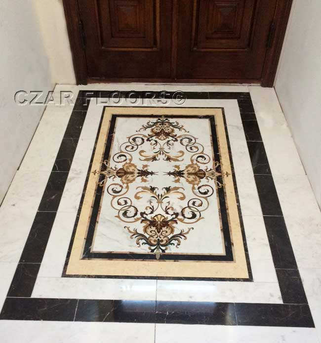 464: Garden medallion in foyer set with matching Emperador Dark and Carrera White marble tile