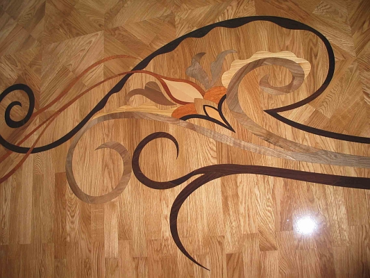 62: Close up of custom floor inlay. Designer-provided images were used to match glass door design