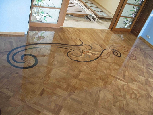 61: Custom Inlay. Entire room floor was prefabricated as numbered tile panels precisely fit
