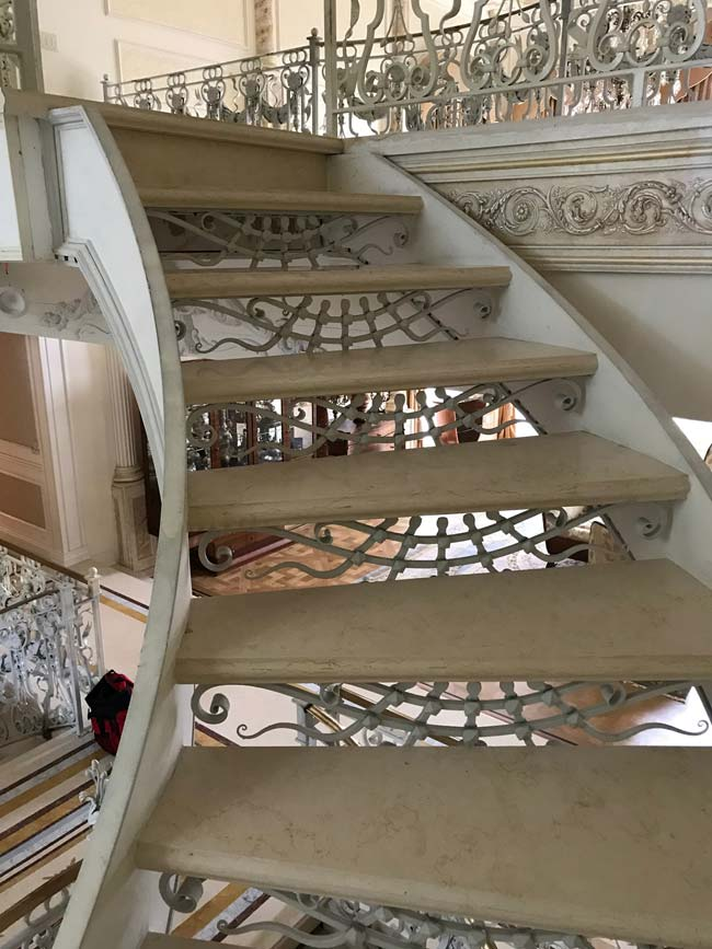 563: Custom marble stairs. Each thread individually made to size from solid slab, polished from 4 sides