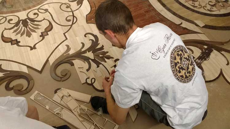 Custom whole room intricate wood rug inlay assembly - fitting the elements