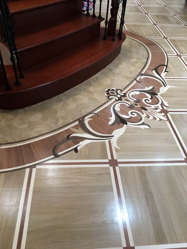 551: Curved Wood Inlay around Stairs