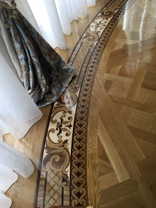 557: Custom curved border with RQ white oak parquet