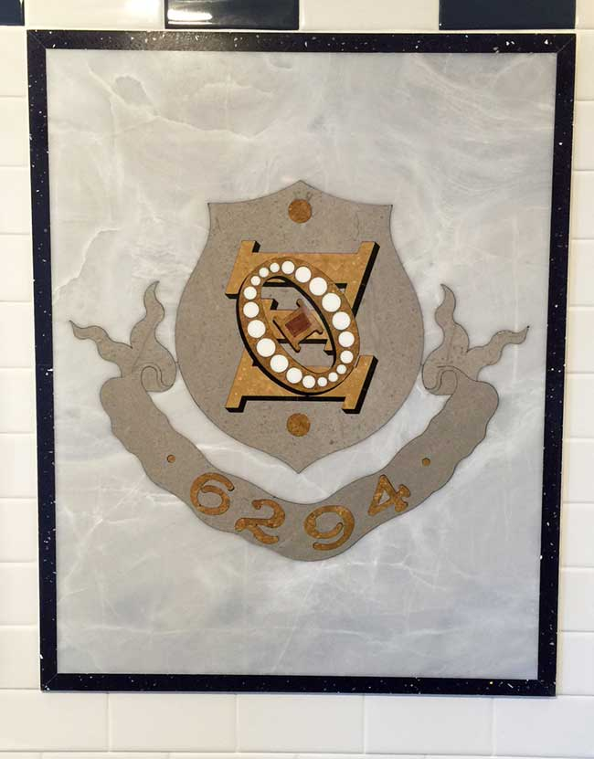499: Marble Fraternity Crest in Bathroom Wall