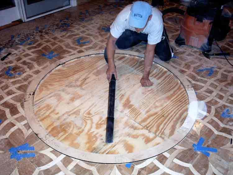 Vacuum cut floor for medallion