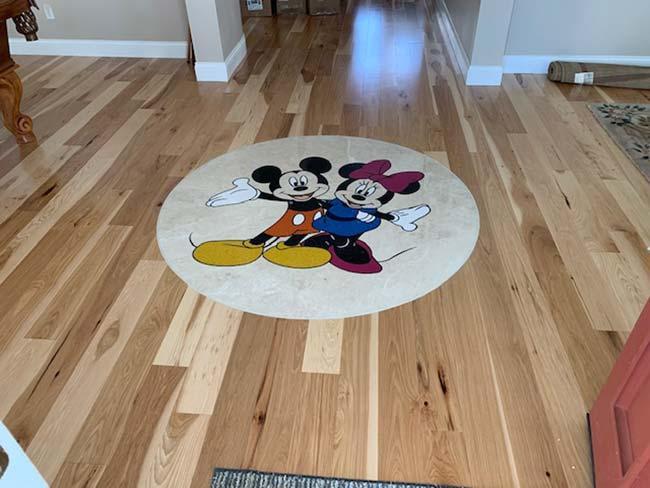 602: Disney theme marble medallion installed in hardwood floors