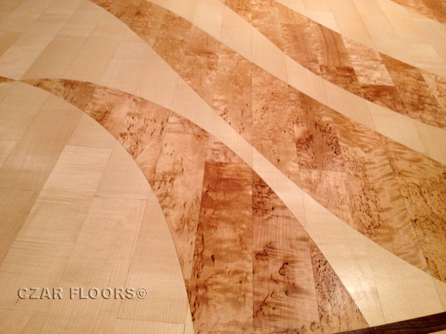 432: Close up on Mega Yacht Lounge floor with Maple and Karerlian Birch inlay