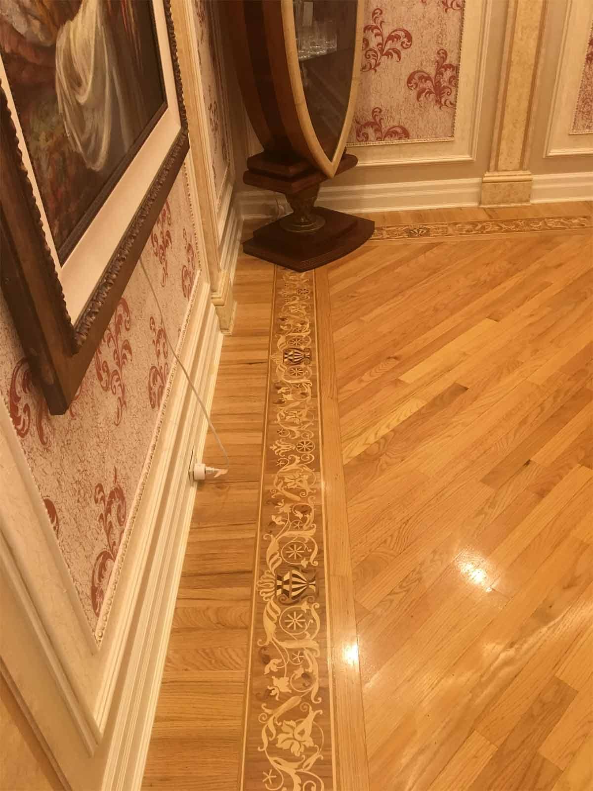 570: Custom wood flooring border to match antique furniture design.