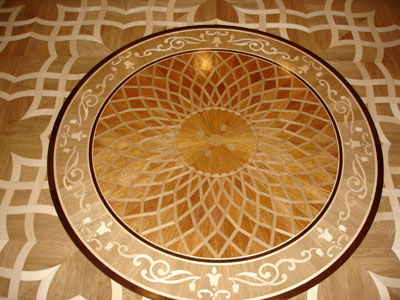 The result of wood medallion installation in parquet. Award winning design Maya