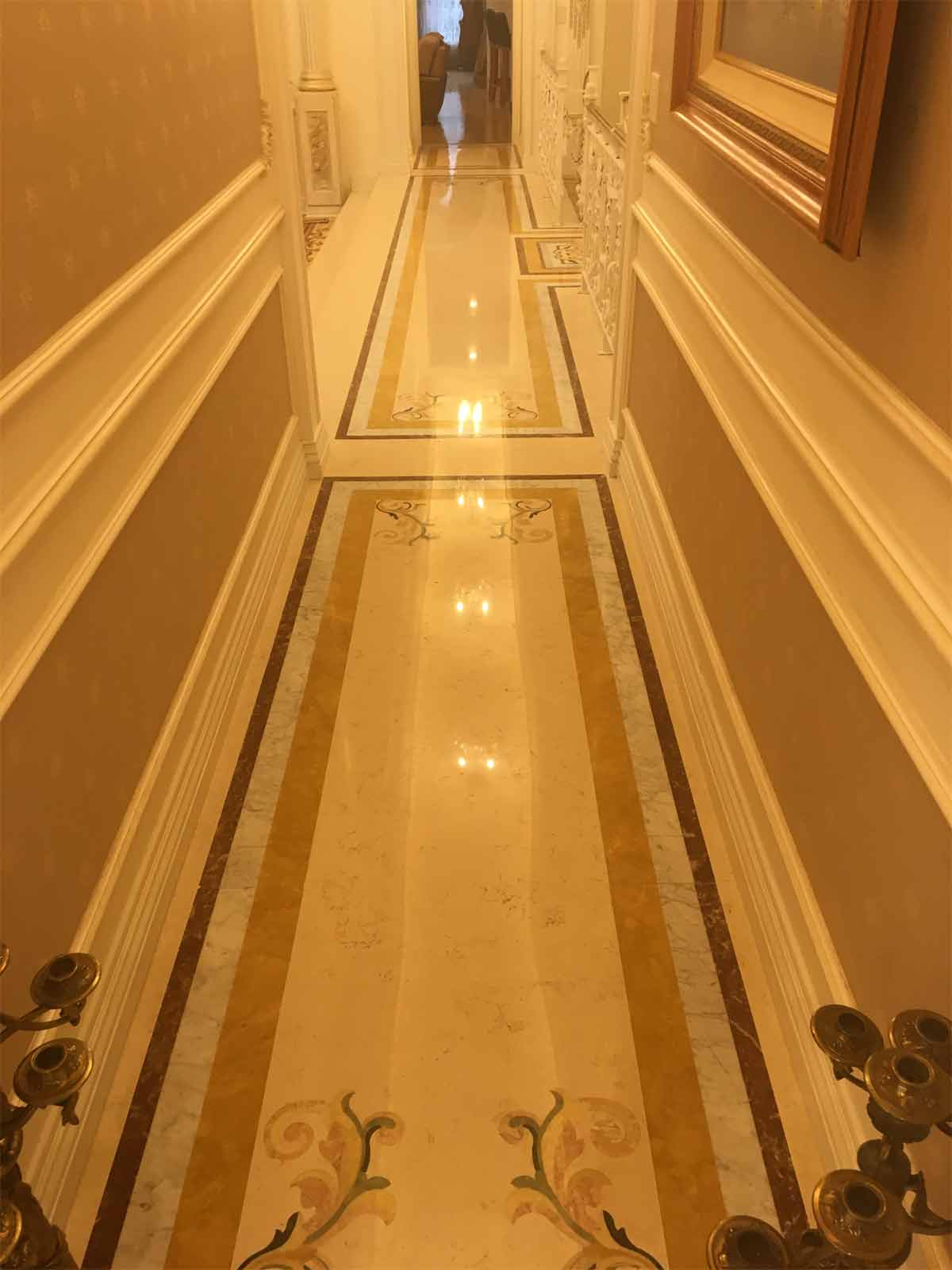 569: Hallway with custom marble inlay.