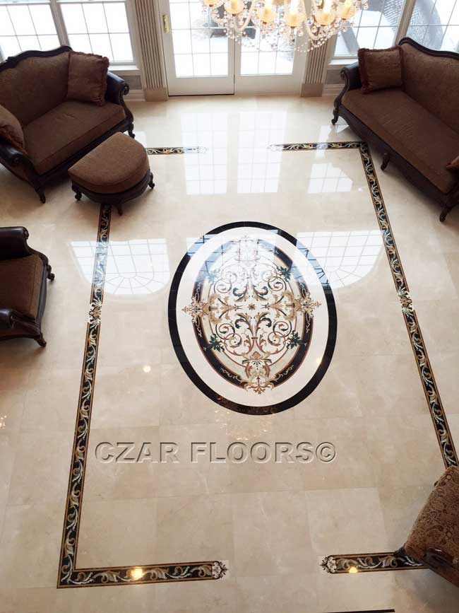 465: Custom scaled marble border and oval medallion in Crema Marfill background tiles