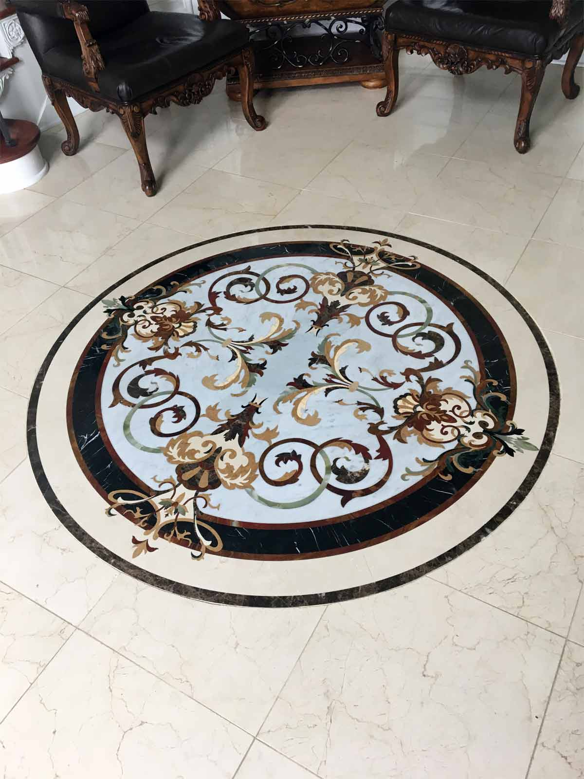 566: Rafael marble floor medallion installed.