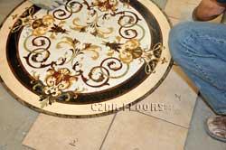 Cutting tiles around waterjet marble medallion installation
