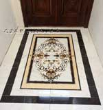 ID:464; Garden medallion in foyer set with matching Emperador Dark and Carrera White marble tile