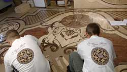 Custom whole room intricate wood rug inlay assembly