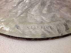 Aluminum backer of the stone waterjet medallion