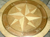 ID:77; Unfinished Compass Rose. The medallion is inside the installation template.