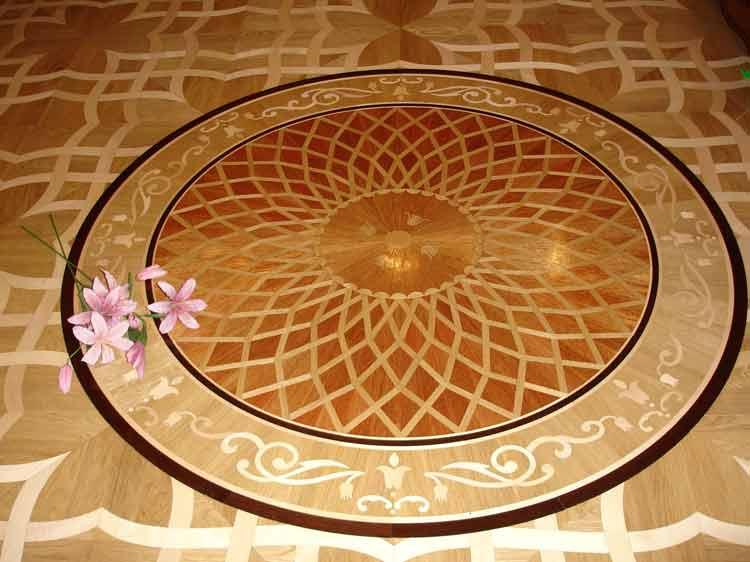 The result of wood medallion installation in parquet. Award winning design Maya